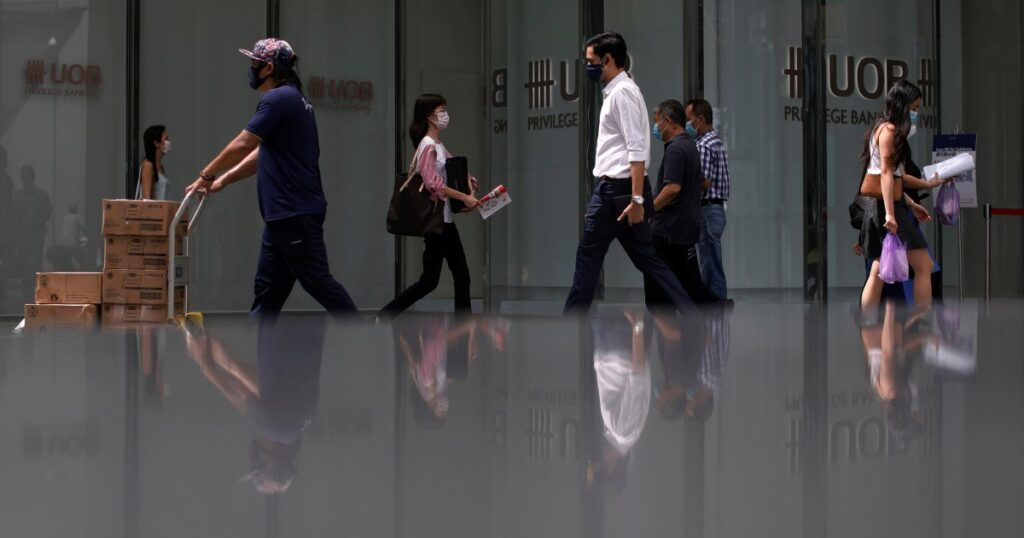 Singapore to open new lane for business travelers, house them in bubble