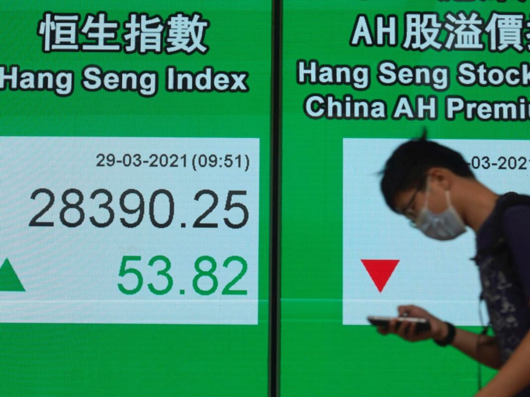 US stocks slip from record heights, weighed down by banks