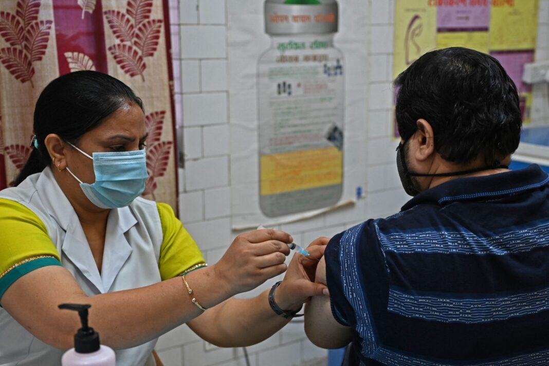 Government vows vaccine push, says will get 217 crore shots from August to December